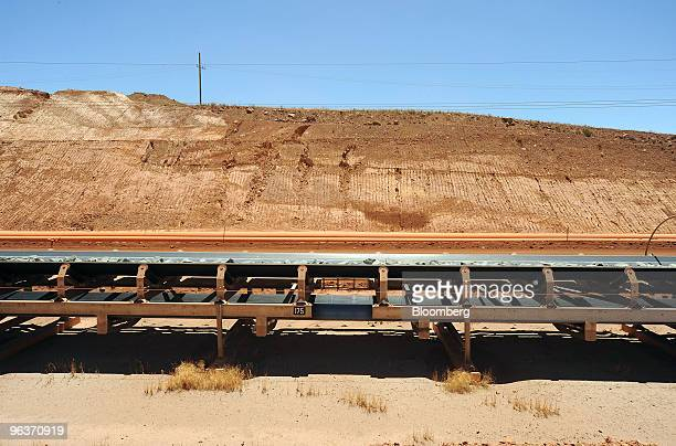 The primary conveyor belt transports crushed rock to the first stage of the gold separation process at Newmont Mining Corp's Boddington Gold mine in...