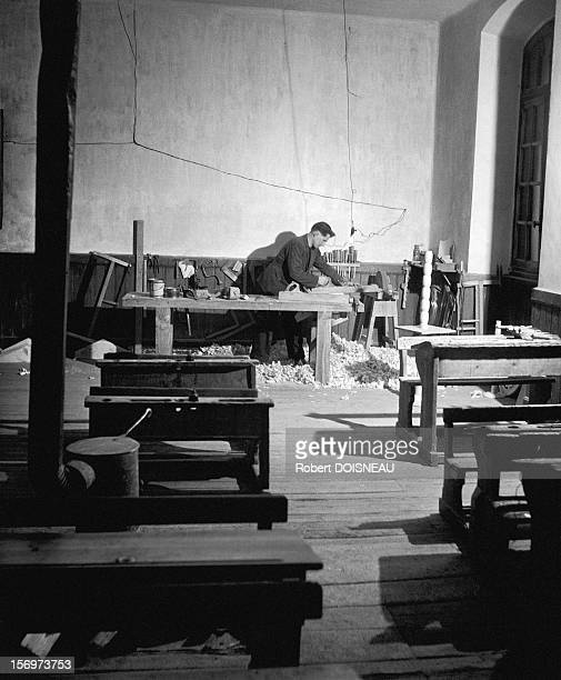 The primary school teacher and joiner working on his desk in the classroom, Saint-Veran, 1947 in Saint-Veran, France.
