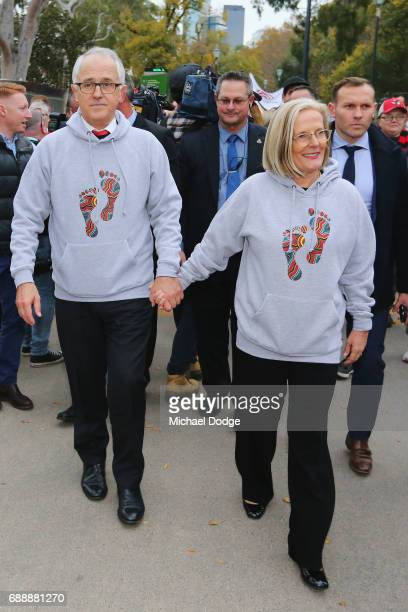 The Prime Minister Malcom Turnbull and his wife Lucy Turnbull join people for The Long Walk during the round 10 AFL match between the Richmond Tigers...