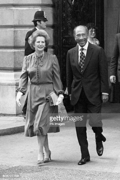 The Prime Minister Margaret Thatcher and President Anwar Sadat of Egypt walking from the Foreign Office to 10 Downing Street for a session of talks...