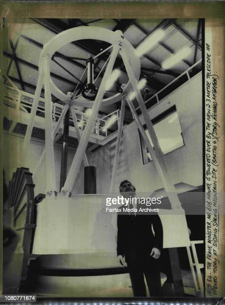 The Prime Minister Mr Bob Hawke is towered over by the new 23metre telescope opened today at Siding Spring mountain site May 16 1984