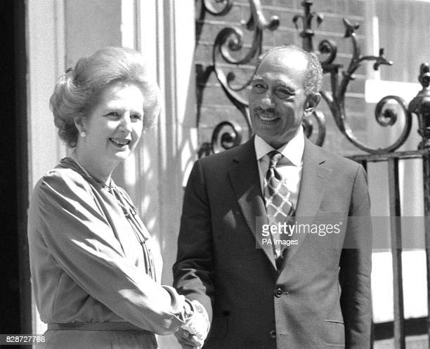 The Prime Minister Mrs Margaret Thatcher shaking hands with President Anwar Sadat of Egypt on the doorstep of 10 Downing Street when they met for...