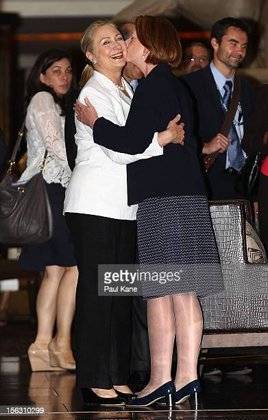 The Prime Minister of Australia Julia Gillard kisses the US Secretary of State Hillary Clinton upon arrival for afternoon tea during the annual...