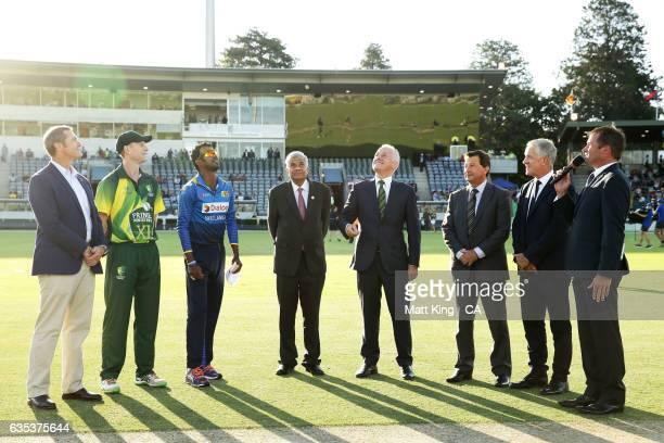 The Prime Minister of Australia Malcolm Turnbull and Sri Lankan Prime Minister Ranil Wickremesinghe take part in the coin toss alongside Adam Voges...