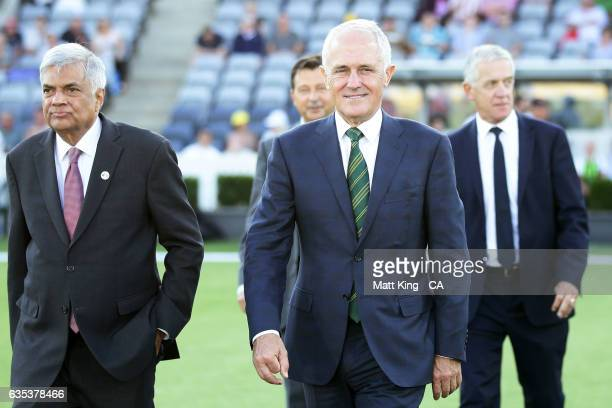 The Prime Minister of Australia Malcolm Turnbull and Sri Lankan Prime Minister Ranil Wickremesinghe walk out to take part in the coin toss during the...