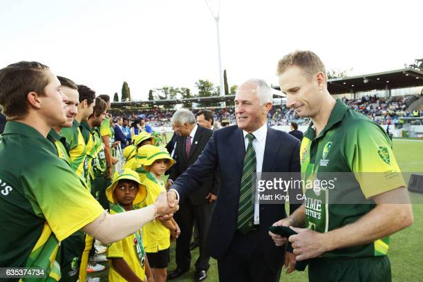 The Prime Minister of Australia Malcolm Turnbull is introduced to members of the PM's XI by captain Adam Voges prior to the T20 warm up match between...