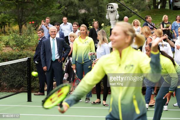 The Prime Minister of Australia Malcolm Turnbull looks on as the Australia and Ukraine teams have a hit of tennis during a Prime Minister's reception...