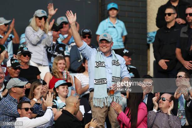 The Prime Minister of Australia Scott Morrison waves to the crowd during the round 10 NRL match between the Cronulla Sharks and the Manly Sea Eagles...