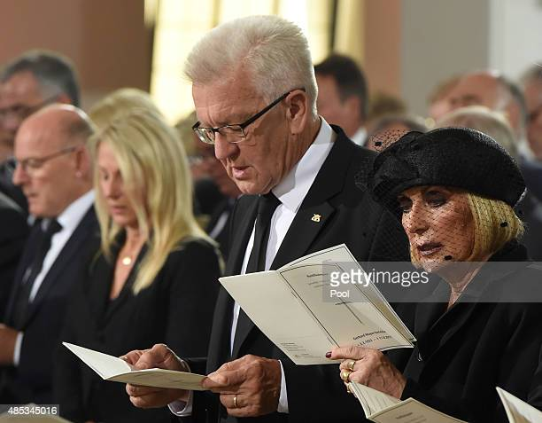 The Prime Minister of Baden Württemberg Winfried Kretschmann and Gerhard MayerVorfelder 's wife Margit attend the Memorial Service of the late former...