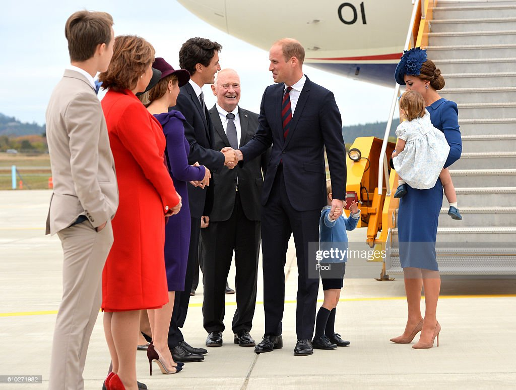 The Prime Minister of Canada Justin Trudeau and his wife Sophie (3rd L) greet Prince William, Duke of Cambridge, Catherine, Duchess of Cambridge, Prince George of Cambridge and Princess Charlotte of Cambridge arrive at Victoria International Airport on September 24, 2016 in Victoria, Canada.
