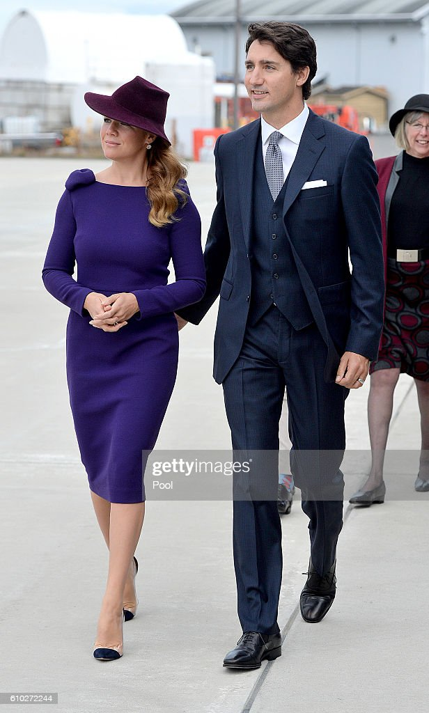 The Prime Minister of Canada Justin Trudeau and his wife Sophie make their way to greet Prince William, Duke of Cambridge, Catherine, Duchess of Cambridge, Prince George of Cambridge and Princess Charlotte of Cambridge as they arrive at Victoria International Airport on September 24, 2016 in Victoria, Canada.