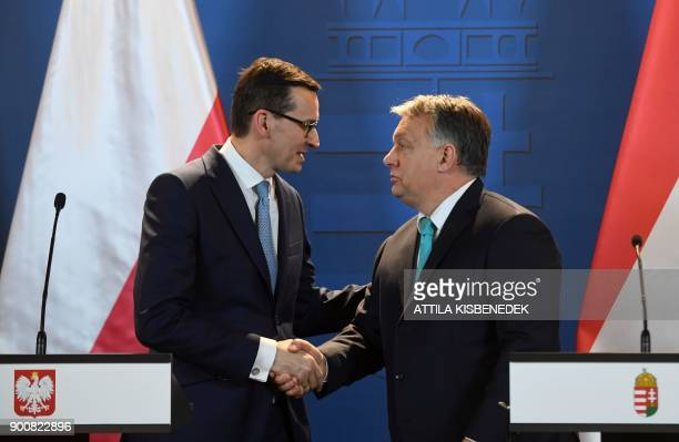 The Prime Minister of Hungary Viktor Orban and his Polish counterpart Mateusz Morawiecki shake hands after giving a joint press conference at the...