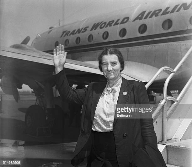 The Prime Minister of Israel Golda Meir is seen waving in front of a plane after arriving in New York City