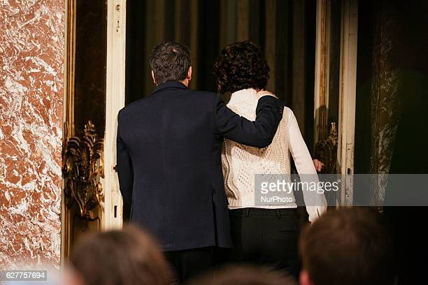The Prime Minister of Italy Matteo Renzi walks away with his wife after admitting his defeat in the constitutional referendum and announcing his...