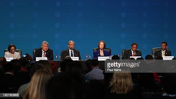 The Prime Minister of Trindad and Tobago Kamla Persad Bissessar the Prime Minister of Samoa Tuilaepa Lupesoliai Sailalel Malieliegaoi the...