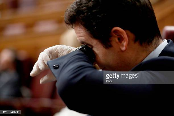 The Prime Minister Pedro Sánchez wipes his face with the back of his hand during the extraordinary plenary session held this Wednesday to explain the...