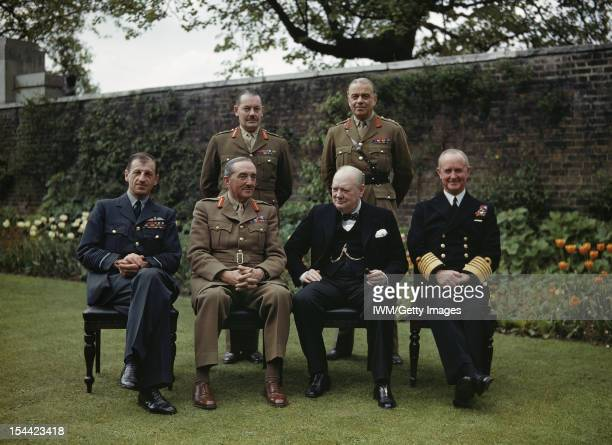 The Prime Minister The Rt Hon Winston Churchill With His Chiefs Of Staff In The Garden Of No 10 Downing Street London 7 May 1945 Seated left to right...