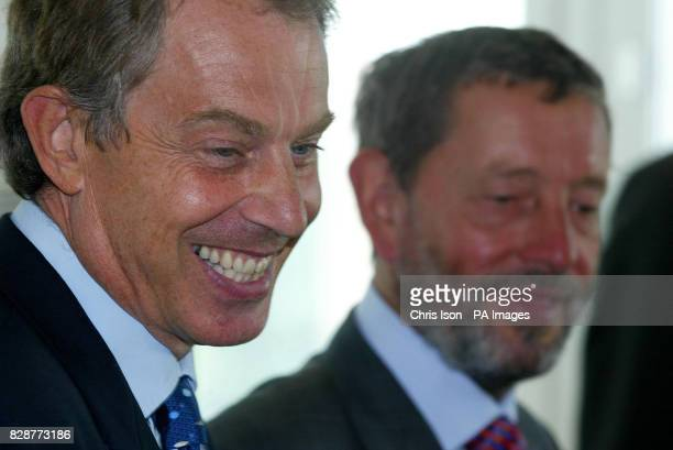 The Prime Minister Tony Blair and the Home Secretary David Blunkett during their visit to the asylum screening unit in Croydon South London The pilot...