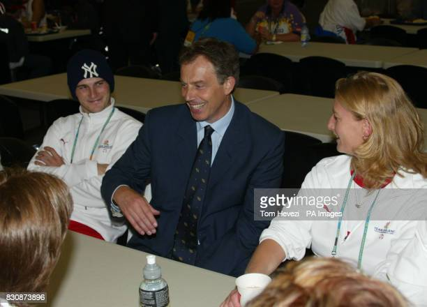 The Prime Minister Tony Blair MP sits between Jimi Lewis and Fiona Geaves both members of the English team at the Athletes village which he visited...