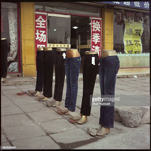The primitive yet effective display of jeans for sale in Feijiacun Artist Village, Chaoyang District, Beijing, China