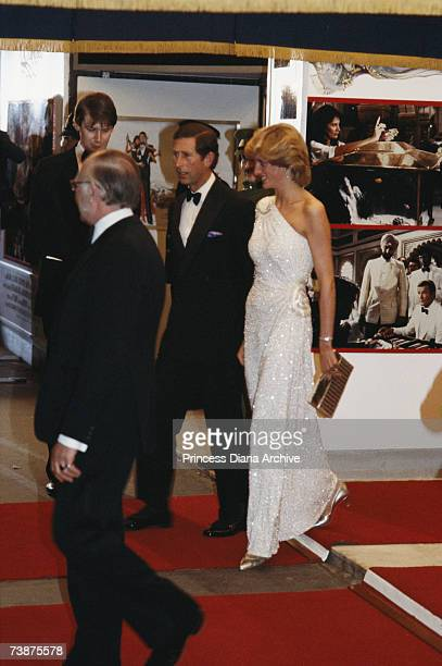 The Prince and Princess of Wales arriving at the premiere of the new James Bond film 'Octopussy' in London, June 1983. Diana is wearing a white...