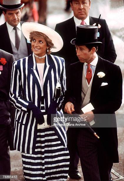 The Prince and Princess of Wales at a Royal Ascot meeting, June 1987. Diana wears a striped suit by Roland Klein and hat by Philip Somerville.