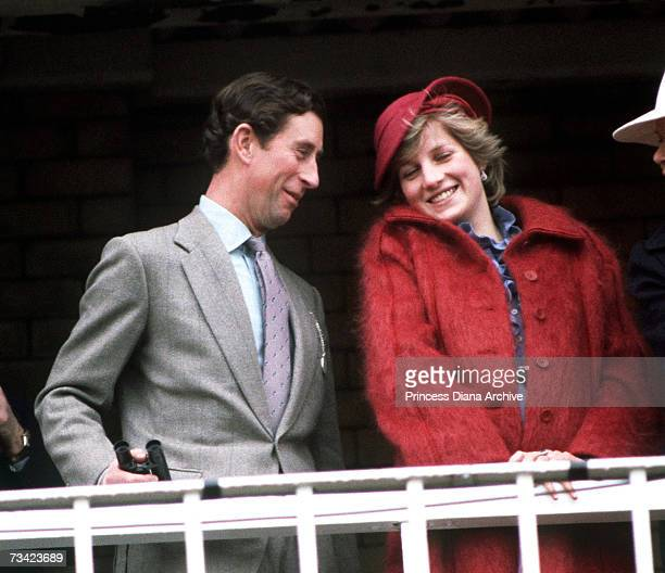 The Prince and Princess of Wales at the Aintree racecourse for the Grand National April 1982 She wears a red mohair maternity coat
