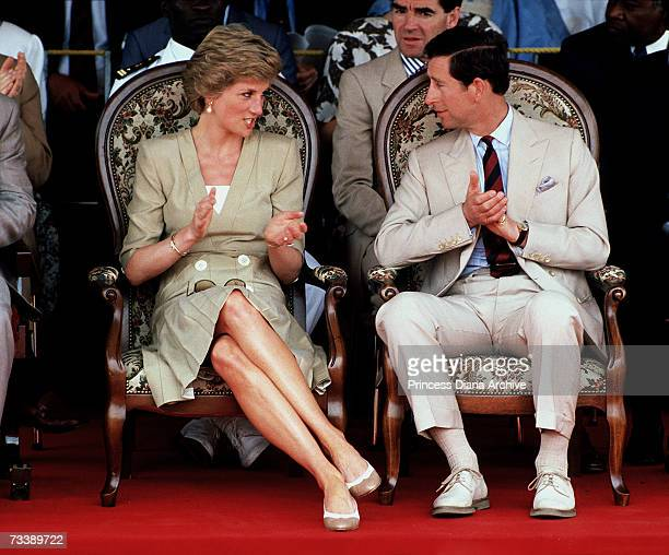 The Prince and Princess of Wales at the Bamenda Electrification Plant in Cameroon March 1990 She wears a Catherine Walker dress