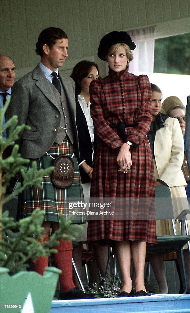 The Prince and Princess of Wales at the Braemar Highland Games in Scotland, September 1981. She wears a tartan suit by Caroline Charles and a tam o'shanter hat.