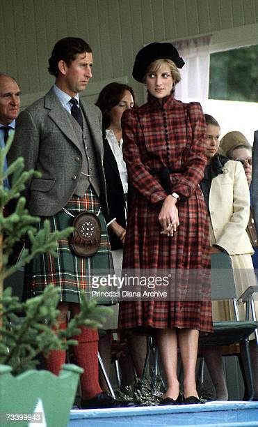 The Prince and Princess of Wales at the Braemar Highland Games in Scotland September 1981 She wears a tartan suit by Caroline Charles and a tam...