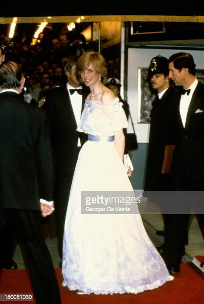 The Prince and Princess of Wales attend a Royal Variety Performance Diana is wearing a chiffon evening dress designed by fashion designer Bellville...