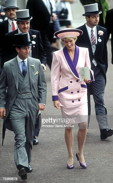 The Prince and Princess of Wales attend the second day of the Royal Ascot race meeting, June 1990. The Princess is wearing a Catherine Walker suit.