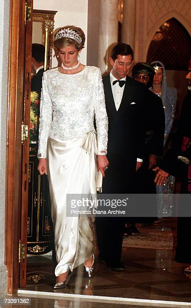 The Prince and Princess of Wales attending a banquet in Muscat, Oman, during an official visit to the Middle East, November 1986. Princess Diana is...