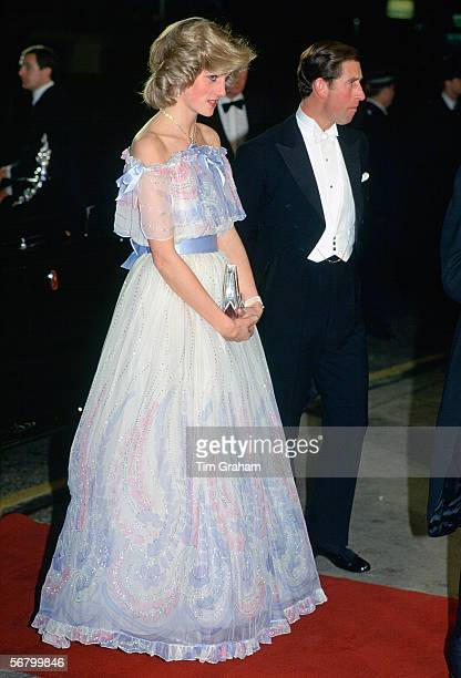 The Prince and Princess of Wales attending a Royal Variety Performance Diana is wearing a chiffon evening dress designed by fashion designer...