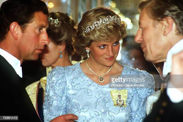 The Prince and Princess of Wales attending a state banquet held by the King of Morocco at Claridges Hotel London 1987 The Princess wears the Spencer...