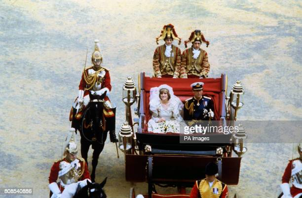 The Prince and Princess of Wales being driven back to Buckingham Palace after their wedding at St Paul's Cathedral.