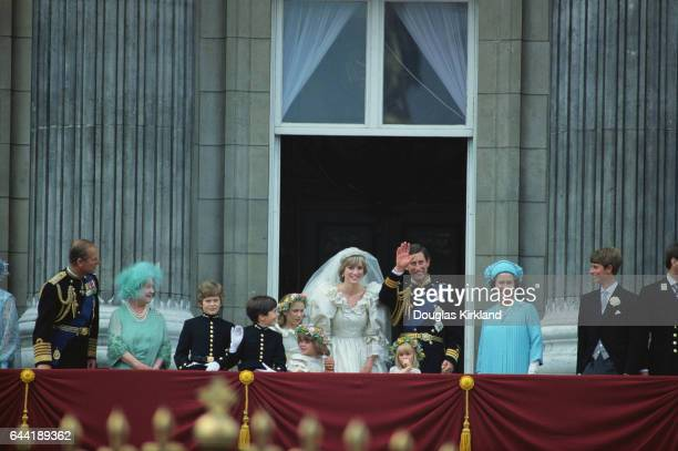 The Prince and Princess of Wales greet the huge crowd and wellwishers from the balcony of Buckingham Palace after their wedding in St Paul's Cathedral