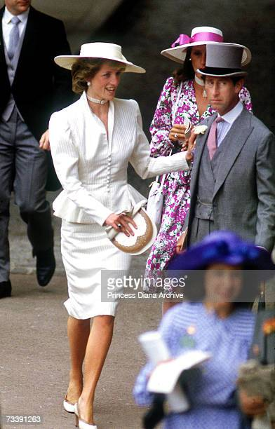 The Prince and Princess of Wales in the royal enclosure at Royal Ascot, June 1986. Princess Diana wears a cream peplum jacket and somerville hat.