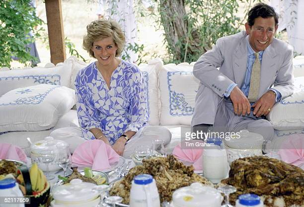 The Prince And Princess Of Wales Laughing Together During A Desert Picnic In Adu Dhabi