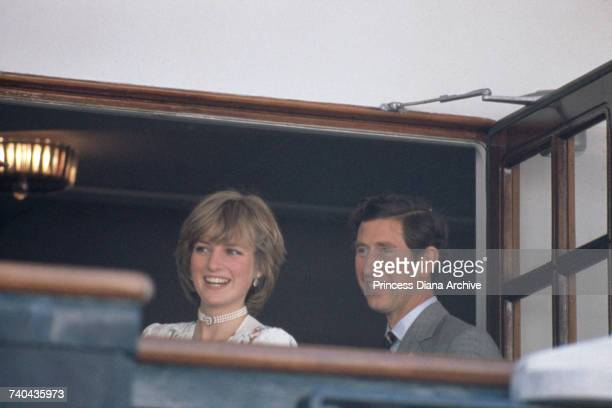 The Prince and Princess of Wales leave Gibraltar on the Royal Yacht Britannia for their honeymoon cruise, 31st July 1981. The Princess wears a Donald...