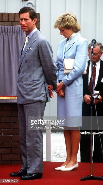 The Prince and Princess of Wales look unhappy during a visit to the Shell lubricant centre near Chester, May 1988. Diana is wearing a pale blue suit...