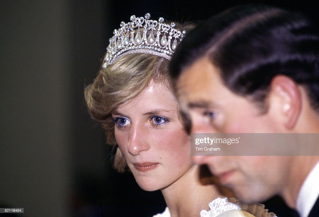 The Prince And Princess Of Wales Looking Unhappy During A Banquet In New Zealand