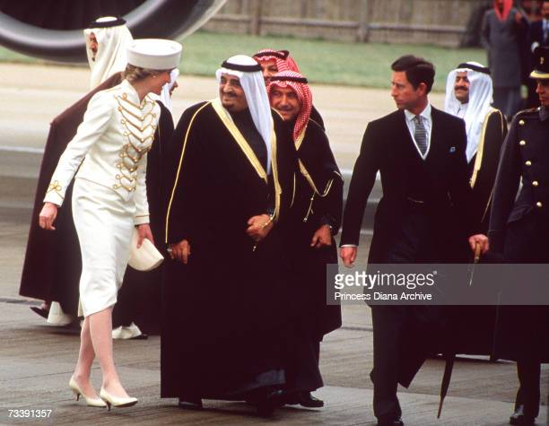 The Prince and Princess of Wales meeting King Fahd and the Saudi Arabia royal family at Gatwick Airport for their state visit to England March 1987...