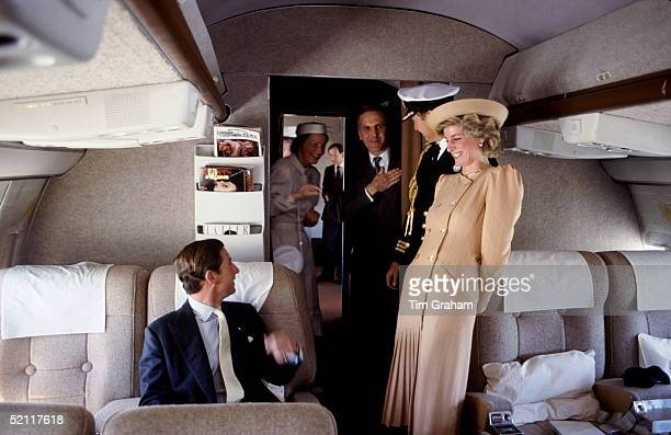 The Prince And Princess Of Wales On Board A Royal Flight To Australia Laughing With Their Staff
