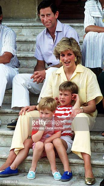 The Prince and Princess of Wales on holiday with their children, Princes William and Harry, at the Spanish royal residence Marivent Palace, August...