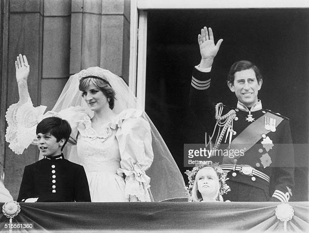 The Prince and Princess of Wales on the balcony with page boy Edward van Cutsom and bridesmaid Clementine Hambro greeting huge crowd gathered in...