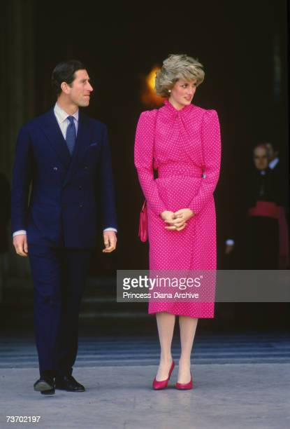 The Prince and Princess of Wales on the steps of St Peter's Basilica in Rome during a tour of Italy April 1985 The Princess is wearing a dress by...