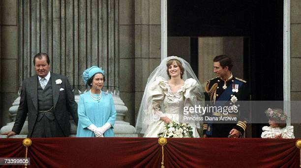 The Prince and Princess of Wales pose on the balcony of Buckingham Palace on their wedding day 29th July 1981 With them are the Queen and Earl...
