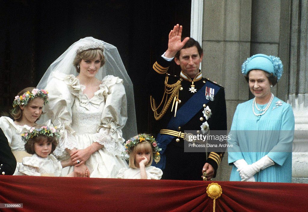 The Prince and Princess of Wales pose on the balcony of Buckingham Palace on their wedding day, with the Queen and some of the bridesmaids, 29th July 1981.