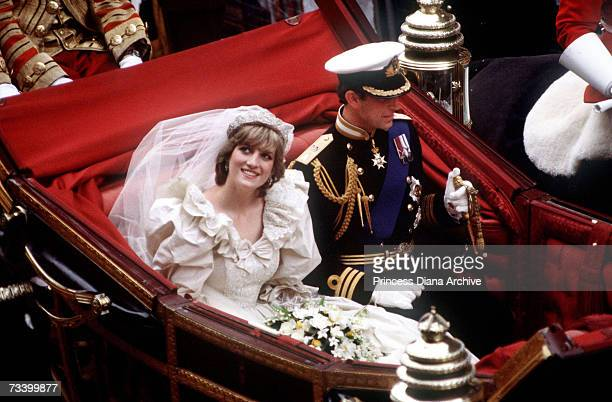 The Prince and Princess of Wales return to Buckingham Palace by carriage after their wedding, 29th July 1981. Diana wears a wedding dress by David...